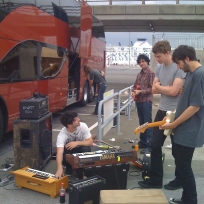 The Foals play an impromptu gig at Calais docks after a side window breaks.